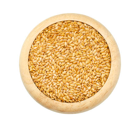 common flax: Gold Flax seeds, Linseed, Lin seeds in wooden dish isolated on white background, Saved clipping path.