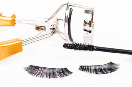 false eyelash: False eyelash mascara and make-up brush on white background.