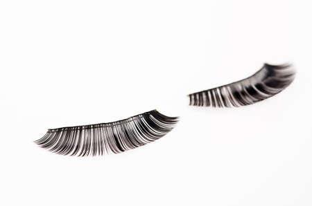 fake eyelashes: Close up a New false Eyelashes style for woman eyes isolated on white background.