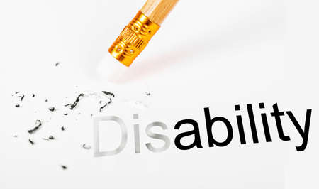 disablement: Changing the word disability to ability with a pencil eraser on white paper.
