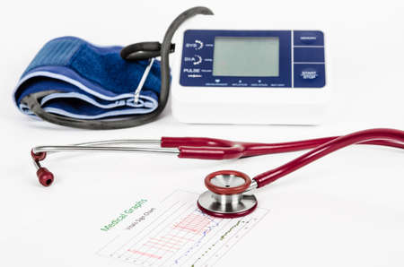vitals: Vitals sign chart, Medical Graphs and Measuring blood pressure with red stethoscope on white background. Vital sign record concept. Stock Photo