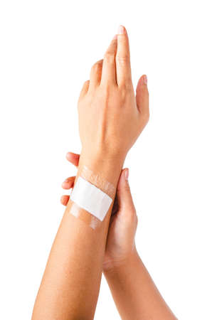 Adhesive bandage with transparent waterproof on hand wooman. Isolated on white background, Saved clipping path.