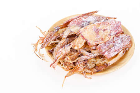 squids: Dried squids in wooden dish isolated on white background.