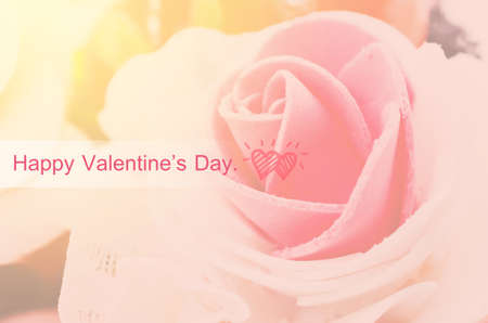 fineart: Happy valentines day on center of rose with day light  background. Stock Photo