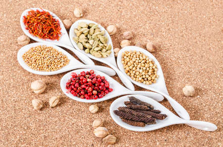 spicey: various spices and herbs on sack background.