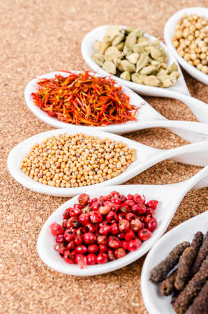 various spices and herbs on sack background.