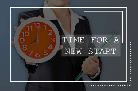 tranfer: Time for a new start with Business wooman showing clock with holding document. Business concept.