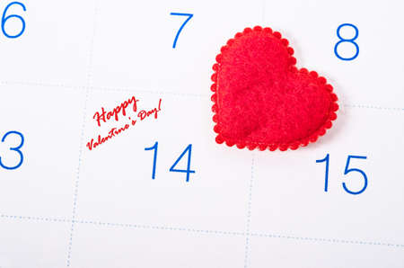 reminding: Happy valentines day with red heart on white calendar page. Stock Photo