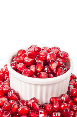 Fresh pomegranate in cup on white background.