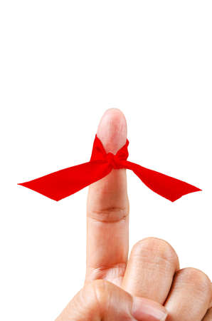Red ribbon on finger isolated on white background, Save clipping path.