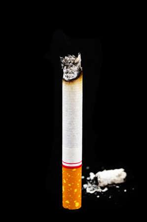 Cigarette on black background.