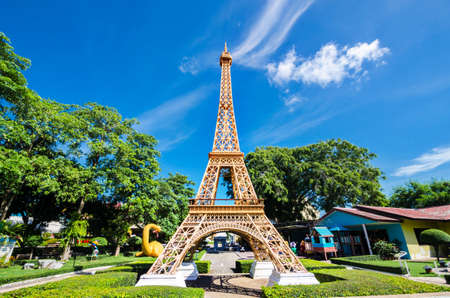reproduce: Eiffel tower replica in Mini Siam Park at Pattaya Chonburi province, Thailand. June 3 2017. Mini Siam is a famous miniature park attraction. It had been constructed in 1986 Editorial