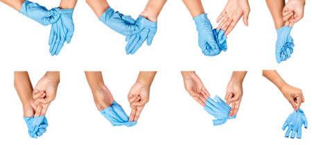 Paso de la mano tirar guantes desechables azules médicos, aislado sobre fondo blanco. Concepto de control de la infección.