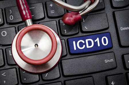 International Classification of Diseases and Related Health Problem 10th Revision or ICD-10 and stethoscope medical on computer keyboard. Reklamní fotografie - 83353061