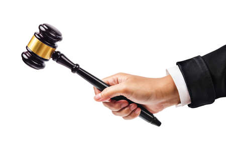 domination: Male hand holding wooden gavel isolated on white background. Save clipping path.