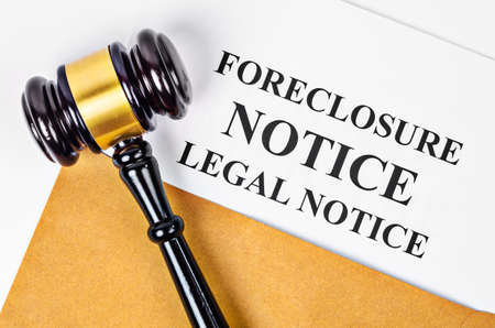 Gavel and Foreclosure Notice document on white background.