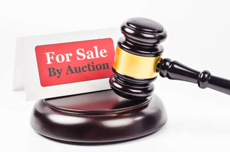 Auction sales with wooden gavel.