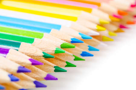 stationery needs: many different colored pencils islolated on a white background