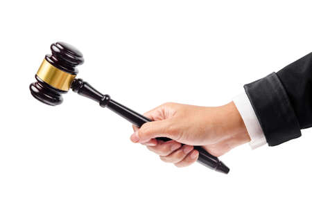 wooden gavel in hand isolated on white background, Save clipping path.
