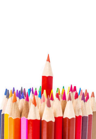 Red pencil standing out from others. Leadership concept.