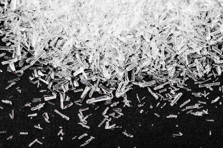 Close up Monosodium glutamate, MSG on black background.