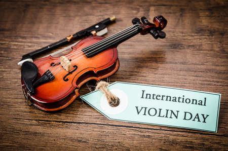 International violin day concept on old wooden background.