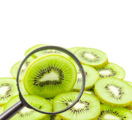 magnifying glass whit whole kiwi fruit isolated on white background.