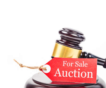 Auction sales with wooden gavel on white background. Business concept. Stock Photo