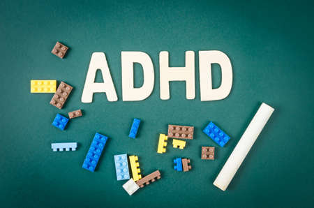 ADHD – attention deficit hyperactivity disorder concept on greenboard.