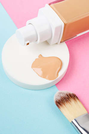 Liquid foundation makeup with brush and sponge on beautiful background;