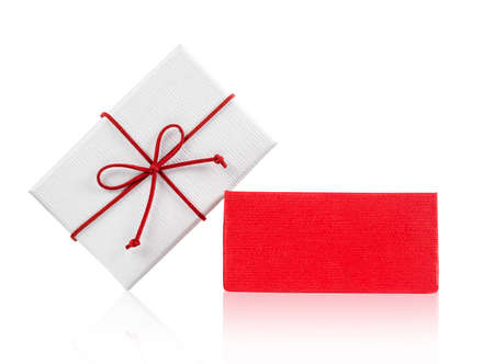 Open white gift box with red bow isolated on white background - Clipping path included
