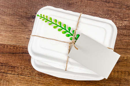 Biodegradable food box with blank tag for your text or message. Eco friendly concept.