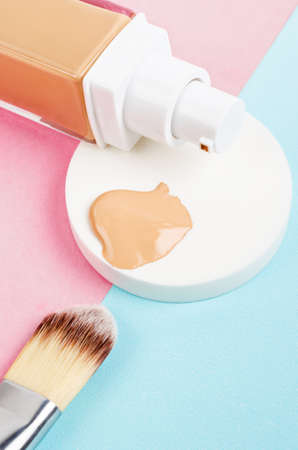 Liquid foundation makeup with brush and sponge on beautiful