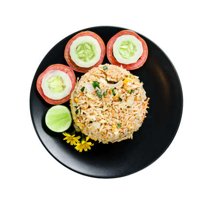 fried rice and vegetable in black dish isolated on white background, save clipping path.