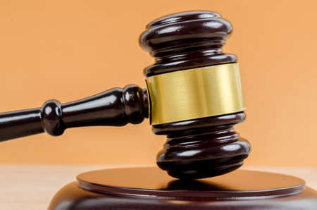 Judge's gavel on the table background. Stock Photo