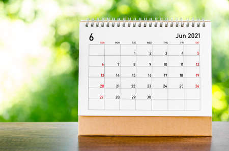 June 2021 Calendar desk for organizer to plan and reminder on wooden table on nature background. Stock fotó