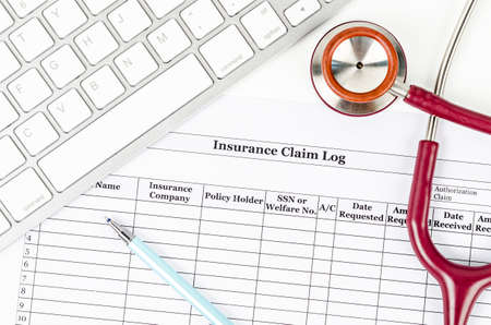 Medical insurance claim log form and stethoscope and keyboard computer. Banque d'images