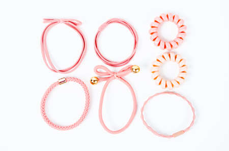 Set of pink fabric rubber bands. Elastic hair ties in vibrant colors on white background. Stockfoto
