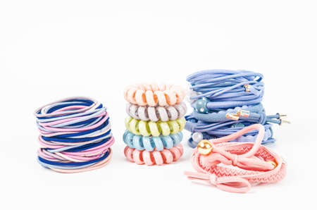 Heap of colorful fabric rubber bands. Elastic hair ties in vibrant colors on white background. Stockfoto