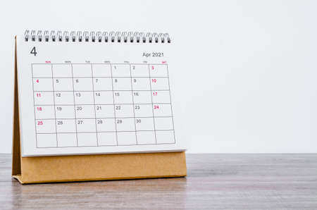 April Calendar 2021 on wooden table background