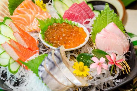 Close up ikura (salmon roe) in sashimi set, Japanese food style. Imagens