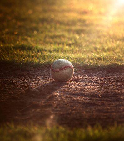Baseball ball lays at the ballpark in the season