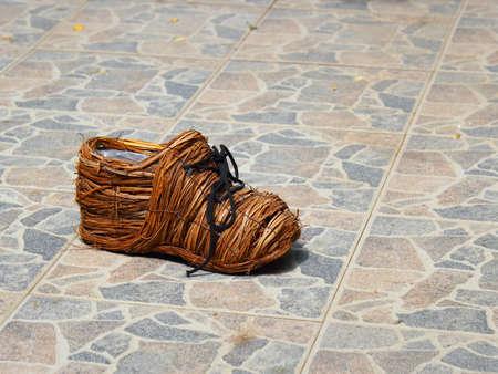 serves: wicker shoe serves as pot Stock Photo