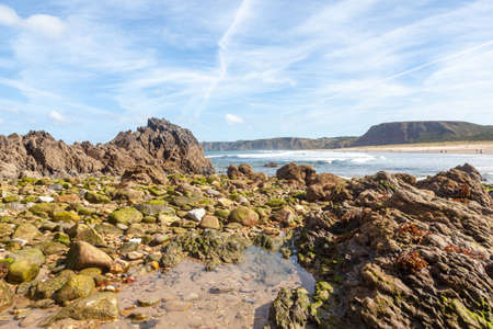 Cliffs and sea rock on the beach of Xago in Spain, blue sky