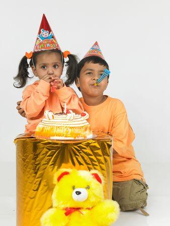 asian children celebrating birthday photo