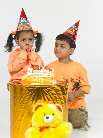 asian kids celebrating a birthday party photo