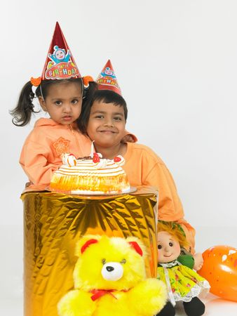 asian kids celebrating a birthday bash photo