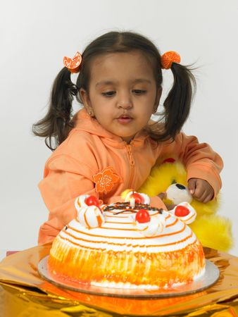 ASIAN GIRL WITH HER BIRTHDAY CAKE photo