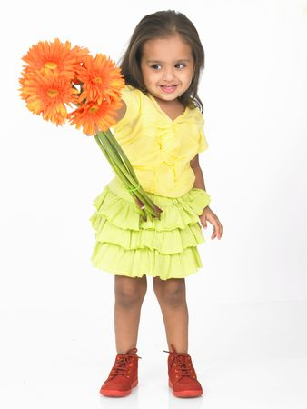 frock: asian kid with gernera flowers Stock Photo