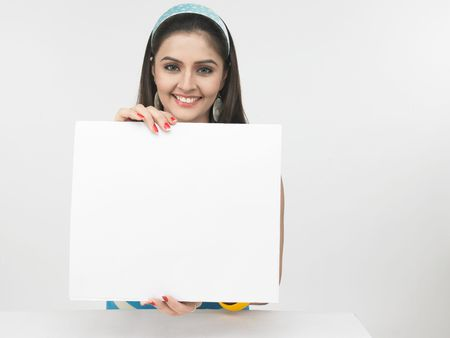 fair woman: asian female with a blank placard Stock Photo